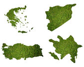 Many world map with grass field — Foto de Stock