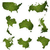 Many world map with grass field — Stock Photo