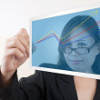 Business woman writing up graph on tablet screen. — Stock Photo