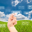 Hand pressing mail world wide on the blue sky field. — Stock Photo