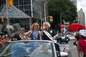 Toronto, Canada - July 1, 2012: Laurel Broten and Cheri DiNovo- Pride Parade Co-Marshals- partaking in the Pride Parade - the closing activity of the Toronto Pride Festival which celebrates the — Stock Photo