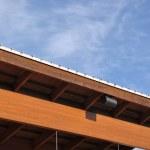 Macro house roof against blue sky — Stock Photo #11524793