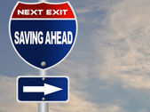 Saving ahead road sign — Stock Photo