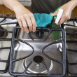 Spraying down Stove Top Range for Cleaning — Stock Photo