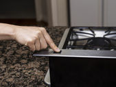 Turning on Range Stove Top Fan — Stock Photo