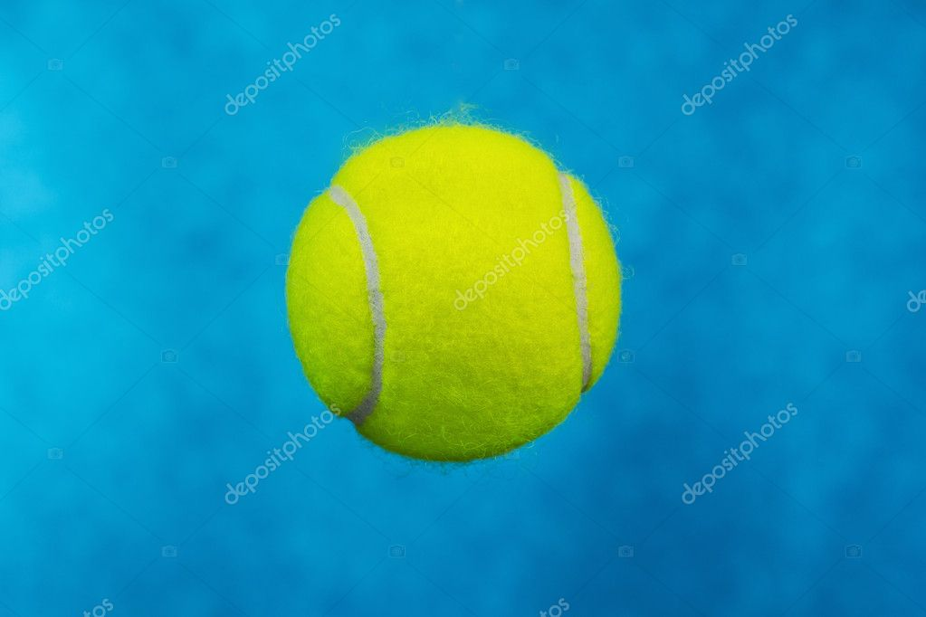 Close up shot of new tennis ball with sky blue background — Stock Photo #11013355