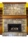 Gas Insert Fireplace with accent walls and shelves — Stock Photo
