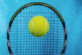 Tennis Balls in Front of Racket — Stock Photo
