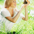 Woman playing with a butterfly — Stock Photo #10738674