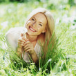 Girl with a dandelion — Stock Photo #10738722