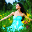 Woman on summer flower field — Stock Photo