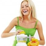 Fitness woman make an orange juice — Stock Photo #10738799