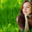 Beautiful woman laying on grass — Stock Photo