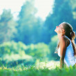 Young woman doing yoga exercise in green park — Stock Photo #10739028