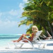 Tropical woman on lounge — Stock Photo