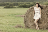 Girl next to haystack — Stock Photo