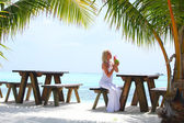 Woman in a tropical cafe — Stock Photo