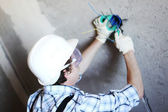 Worker puts the wires — Stock Photo