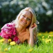 Girl on dandelion field — Stock Photo