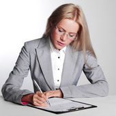 Business woman writing in notebook — Stockfoto