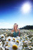 Girl in dress on the daisy flowers field — Stock Photo