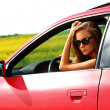 Woman in red car - Stock Photo