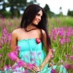 Woman on flower field — Stock Photo #11016949