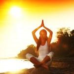 Ocean yoga sunrise — Stock Photo #11017014