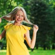 Happy woman in forest — Stock Photo