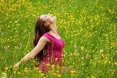 Woman on flower field — Stock Photo