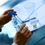 Businessman drinking water — Stock Photo
