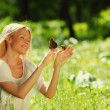 Woman playing with a butterfly — Stock Photo #11271577