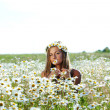 Royalty-Free Stock Photo: Girl on the daisy flowers field