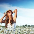 Girl in dress on the daisy flowers field — Stock Photo #11287544