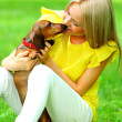 Woman dachshund in her arms — Stock Photo #11287642