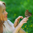 Woman playing with a butterfly — Stock Photo #11287811