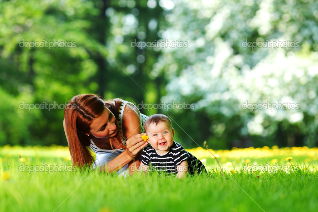 Happy mother and daughter on the green grass  Stock Photo #11287809