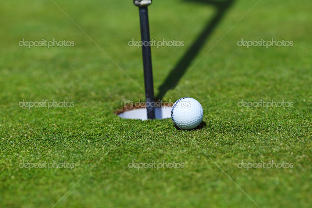 Golf ball on lip of cup — Stock Photo #11365877