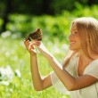 Woman playing with a butterfly — Stock Photo #11439932