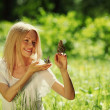 Woman playing with a butterfly — Stock Photo #11439934