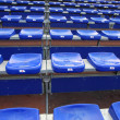 Many blue and yellow vip seat in football stadium - Stock Photo