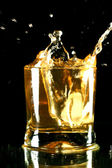 Whiskey splash — Stockfoto