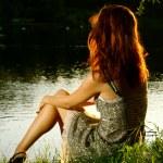 Beautiful woman on the lake shore — Stock Photo #11599220