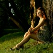 Stock Photo: Beautiful woman under the tree