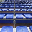 Many blue and yellow vip seat in football stadium — Stok fotoğraf