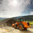 Excavator in alps — Stock Photo #11821498