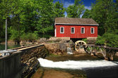 Historical building of Old water sawmill and small dam. — Stock Photo