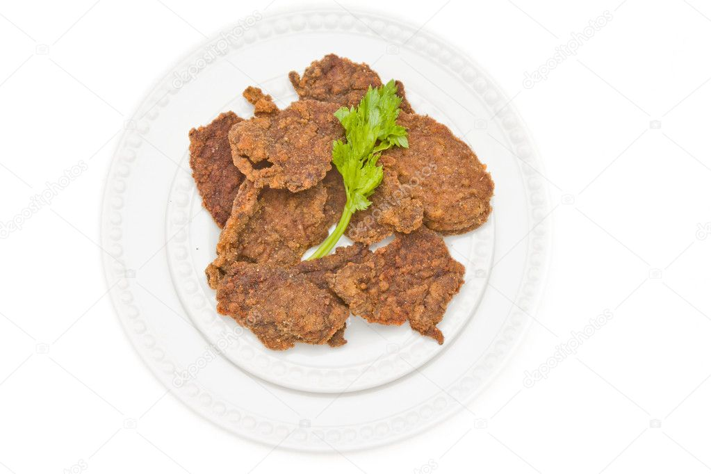 Chicken cutlet served on a plate and decorated with parsley leaf — Stock Photo #11118794