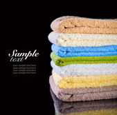 Stack of folded towels — Stock Photo