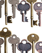 Vintage keys on isolated white background — Stok fotoğraf